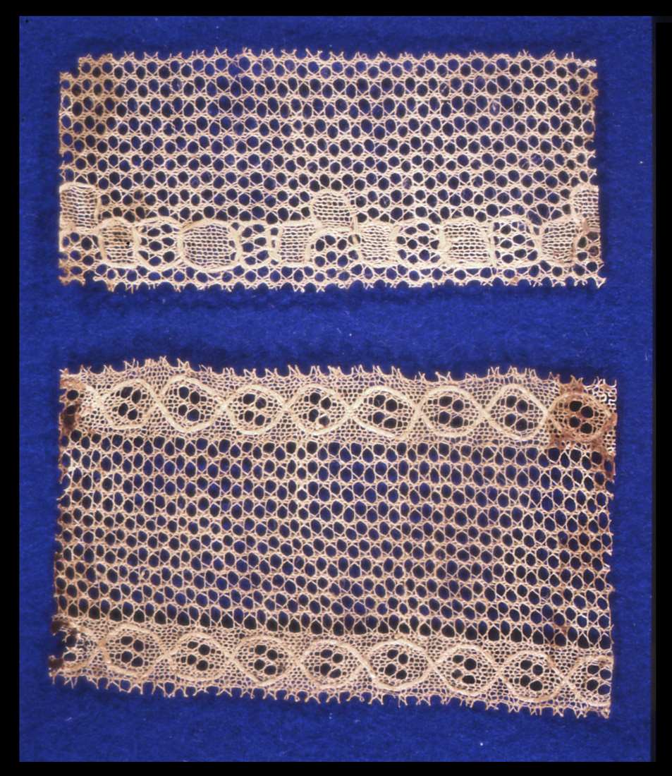 The earliest machine-made lace was made on the stocking-frame by transferring stitches to make a net. These two borders have a simple geometric pattern in plain knitting, net in transfer stitches and outlines put in by hand. Nottingham City Museums